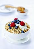 A bowl of muesli with fresh berries and yogurt