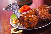 Spicy grilled chicken legs (India)