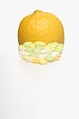 Vitamin tablets and a lemon
