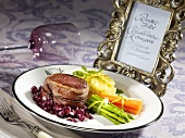 Beef fillet with shallot compote and a bunch of vegetables