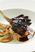 Saddle of wild boar with red wine pears and figs (Asia)