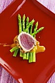 Tuna with a spicy crust on green asparagus with a soya dressing