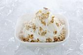 Yogurt ice cream garnished with muesli