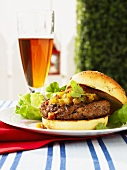 Curried lamb burger with mango chutney and beer