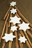 Cinnamon sticks forming the shape of a Christmas tree with cinnamon stars on top