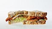 A schnitzel sandwich, halved