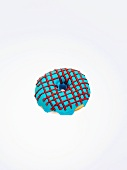 A doughnut with blue ice and red stripes