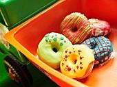Colourful doughnuts in a toy car