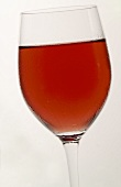 A glass of rosé wine with condensation