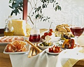A table laid with antipasti and red wine
