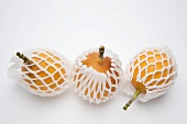 Three granadilla in net packaging