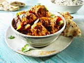 Jalfrezi (spicy meat curry, India) with flatbread