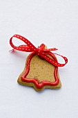 Bell-shaped Christmas biscuit with red bow