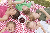 Children eating cherries