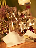A festively decorated table with white wine