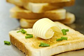 Toast with a curl of butter and chives