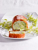 Avocado and salmon roulade with bean sprouts