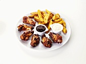 Barbecue chicken wings with potato wedges and dips