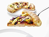Ham and vegetable pizza with cheese-filled crust