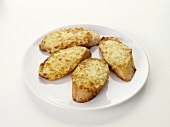 Toasted cheese on baguette slices with garlic