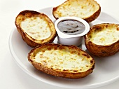Baked potatoes with cheese and dip