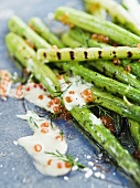 Grilled green asparagus with sour cream and caviar