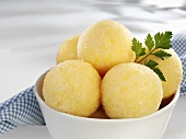 Several potato dumplings in bowl