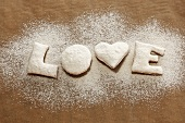 'LOVE' biscuits with icing sugar