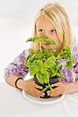 Girl with a pot of basil