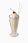 Vanilla milkshake with cream and cherry