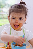 Girl eating pasta with bolognese sauce