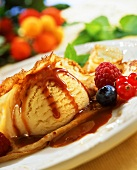Crêpes with ice cream, berries and caramel sauce