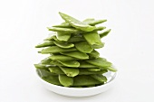 Mangetout (stacked) on plate