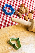 Rolling pin, biscuit cutters and nuts with wooden board