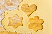 Biscuit dough with the shapes of cut-out biscuits