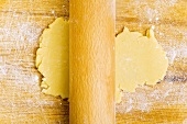 Rolling out biscuit dough with rolling pin