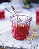 A glass of strawberry and elderflower jam