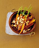 Gratinated honey-glazed carrots with sheep's cheese, orange and sesame seeds
