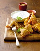 Lamb samosas with yogurt