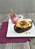 An aubergine filled with couscous and vegetables