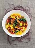 Vegetable curry with pork and tagliatelle
