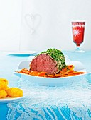 Roast beef with herbs and carrots