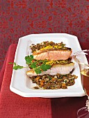 Lentils with fish fillets in serving dish