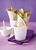 Wraps with chicken, carrots and sprouts