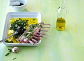 Marinated rack of lamb with olive oil, herbs and garlic