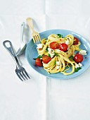 Spaghetti with cherry tomatoes, parsley and sheep's cheese
