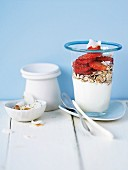 Yogurt with muesli and fresh strawberries for breakfast