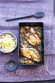 Baked chicken breast with thyme and a bowl of tagliatelle