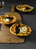 Goat cheese tarts on wooden serving plate