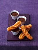 Choux pastry churros with a chocolate dip